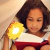 Little-girl-reading-with-Little-Sun-Original_credit-Franziska-Russo
